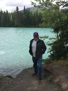 Tom standing next to the Kenai River.